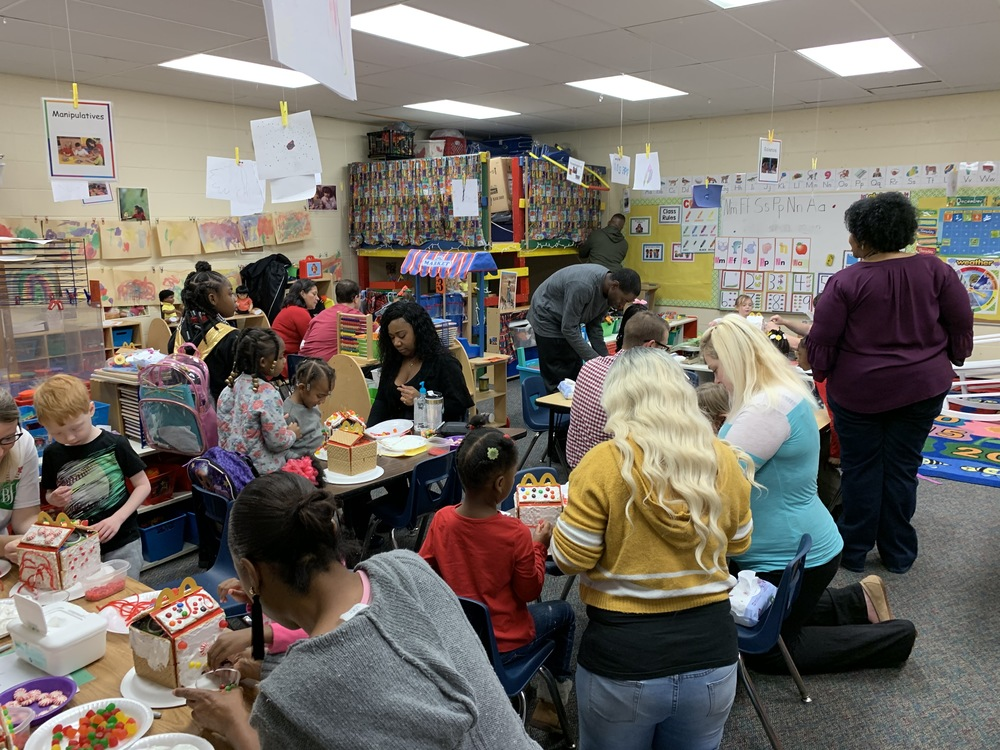 Pre-K making Gingerbread Houses