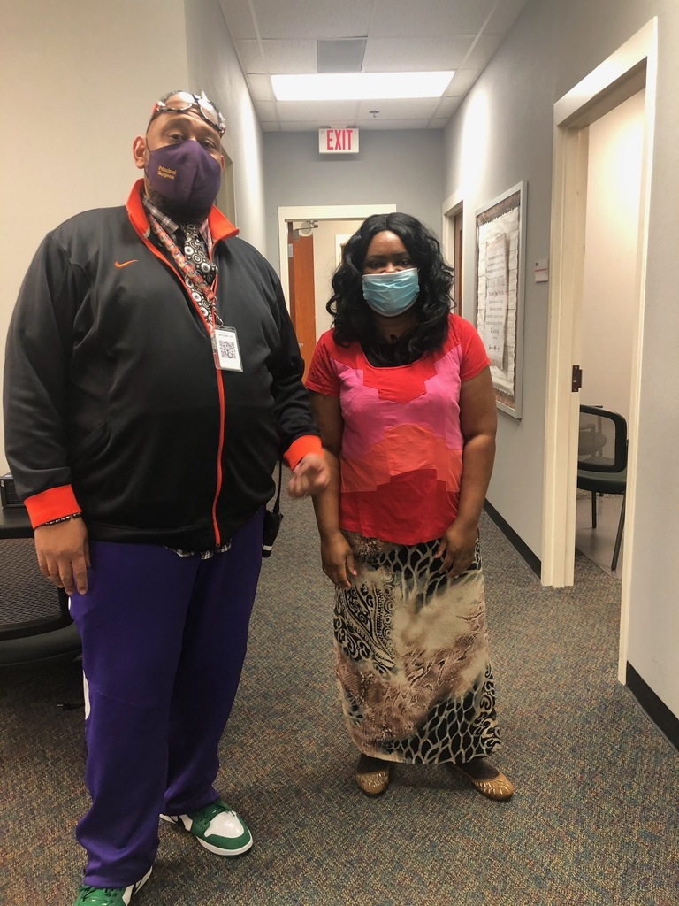 Principal Burgess and Ms. Evans mismatched day/ pictures from crazy sock day