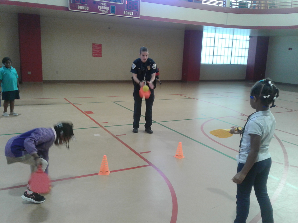 Officer playing with students in PE class