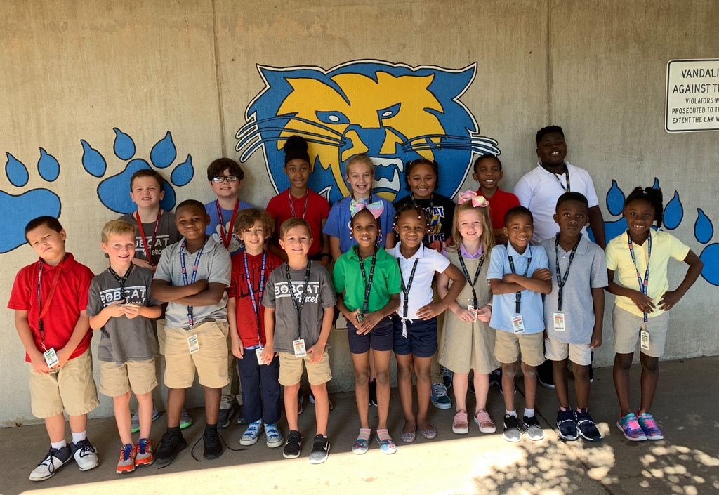Oakbrooke students show off our new PBIS lanyard badges.