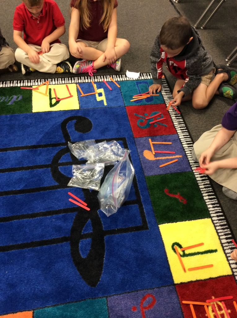 Kindergarten is learning how to notate rhythm and beats using popsicle sticks.