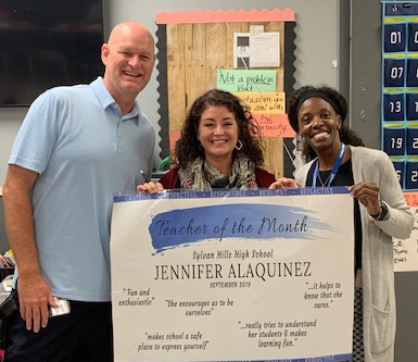 Spanish Teacher Jennifer Alaquinez, Teacher of the month with assistant principal Quynci Williams and principal Tracy Allen
