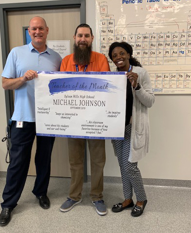 Science teacher Michael Johnson, Teacher of the month with assistant principal Quynci Williams and principal Tracy Allen