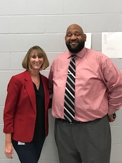 Mr. Burgess and Ms. DeVun honor World Dyslexia Day by wearing red.