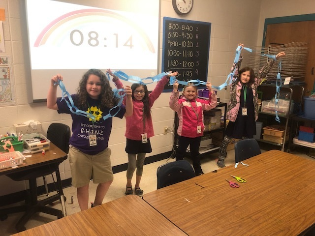 The students were broken up into teams and could only use the supplies given to them. The team that has the longest paper chain at the end of the 20 minutes were the winners.