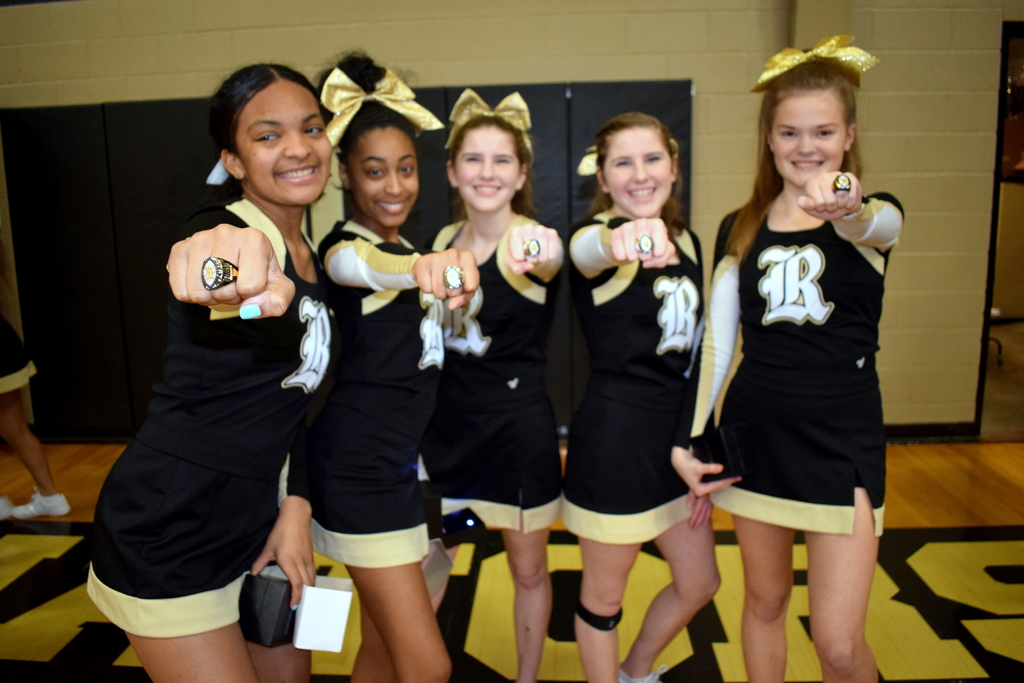 Robinson cheerleaders with championship rings