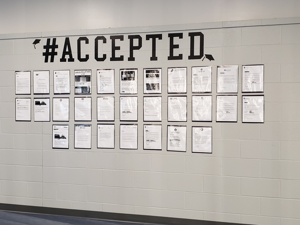 Acceptance letters posted on wall