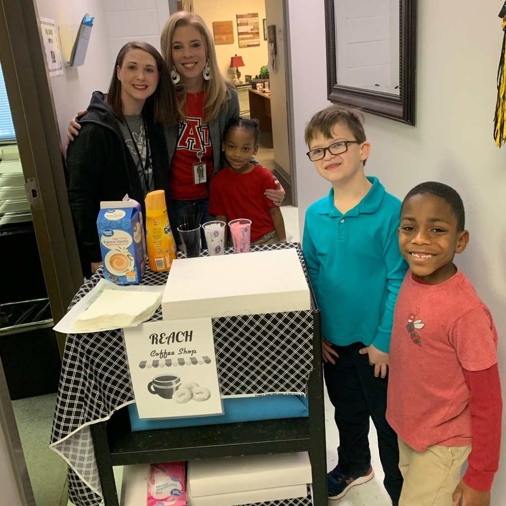Students and teachers around a coffee cart